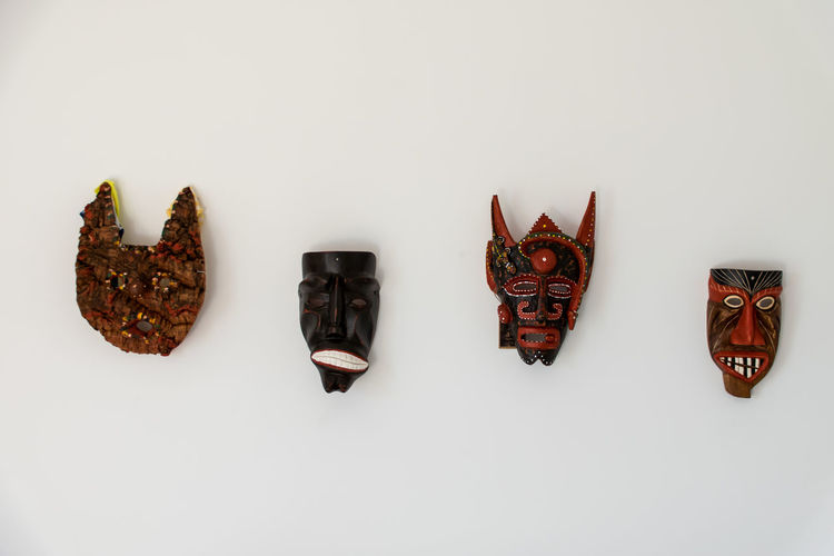 Mask in the wall. Day Mask No People Protective Glove Shoe Studio Shot Tradition White Background