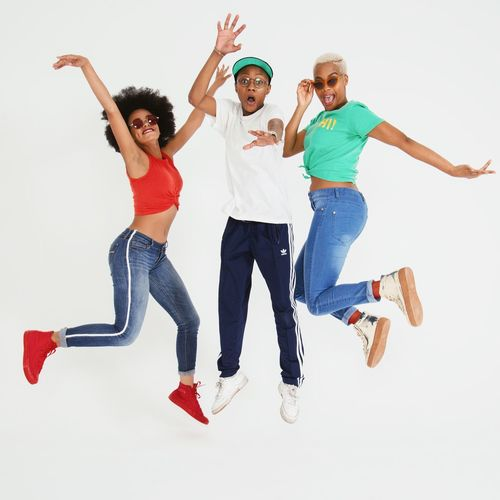 Full Length Happiness Emotion Human Arm Fun Enjoyment Jumping Smiling Togetherness White Background Studio Shot Group Of People Leisure Activity Arms Raised Young Adult Lifestyles