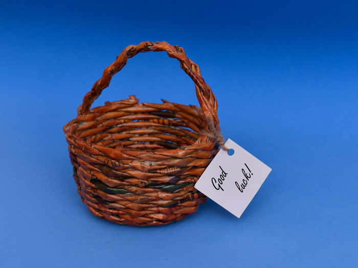 wooden basket with note Baked Basket Blue Blue Background Brown Close-up Communication Container Copy Space Food Food And Drink Freshness Heart Shape Indoors  No People Snack Still Life Studio Shot Text Western Script Wicker