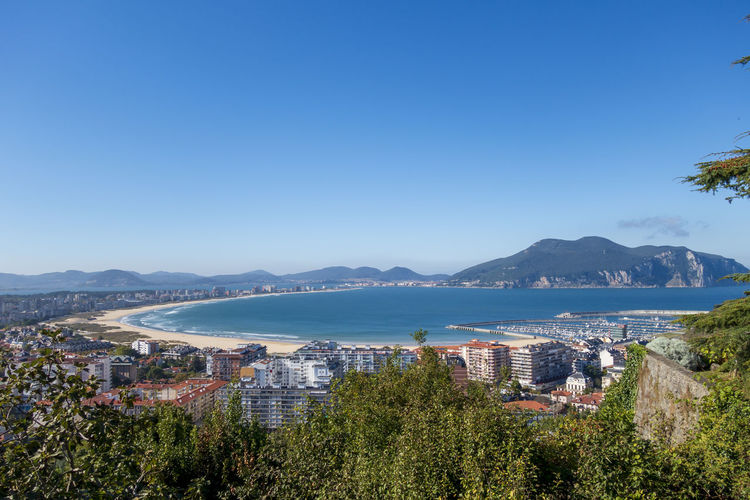 Laredo beach in Cantabria, Spain Mountain Building Exterior Architecture Sky Built Structure Nature Water Clear Sky City Building No People Blue Cityscape Outdoors Bay Beach Sand Cantabria Laredo Ocean Gulf Aerial View