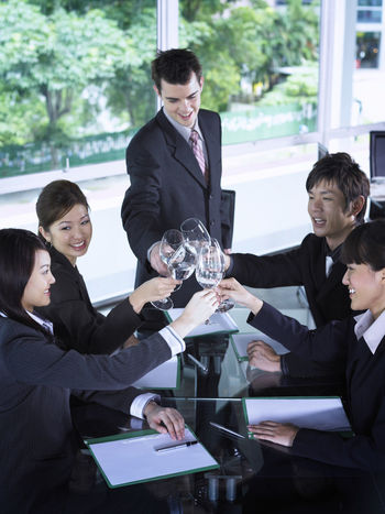 group of business people at restaurant Business Celebration Collaboration Food And Drink Full Suit Happiness Lunch Refreshment Toasting Well-dressed Wine Glass Businessman Businesswomen Colleague Corporate Business Formalwear Group Of People Hotel Lunch Meeting Occupation Refreshment Restaurant Success Togetherness Wine