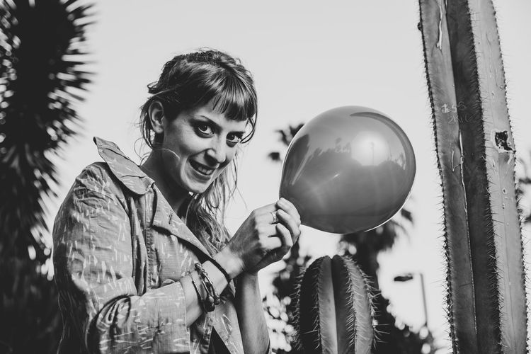cactus One Person Portrait Looking At Camera Balloon Casual Clothing Happiness Child Emotion Outdoors Blackandwhite Cactus Ballon Cactus Flower Cactus Garden Desert Girl Women Surprise Mischief Mischievous Explosion Day Young Adult Young Women Black And White
