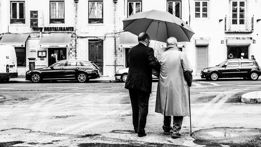 Family People Day Men In Suits Suitstyle Suit Walking Sunday Walk Sunday Walking In The City Walking Streets Old Fashioned Scene Old Fashioned. Father And Son Umbrella Classic 2 Men Old Man Family Bnwstreetphotography Bnwphotography Streetphotography Blackandwhite