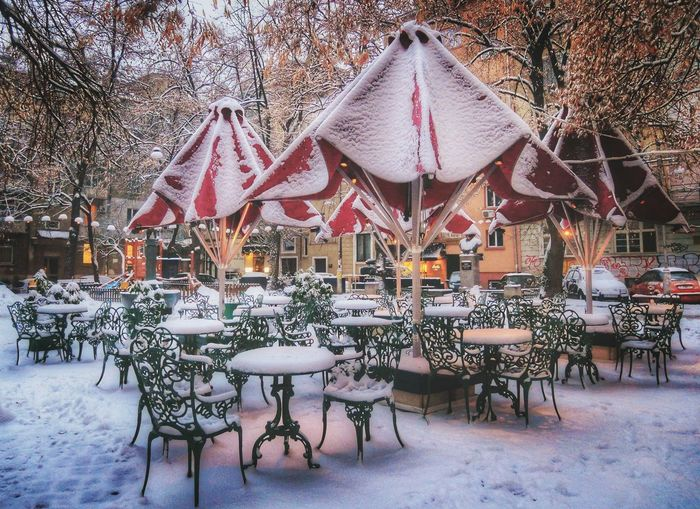 Empty chairs and tables in restaurant during winter