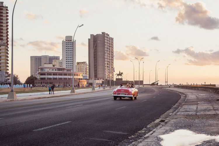 Malecón, Havana, Cuba The Street Photographer - 2018 EyeEm Awards The Traveler - 2018 EyeEm Awards This Is Latin America Been There. Cars Cuba Havana Malecon Architecture Building Exterior Built Structure Car City Cityscape Enjoying Life Land Vehicle Modern Outdoors Road Sky Skyscraper Street Streetphotography Sunset Tall Transportation Travel Destinations Vintage Cars