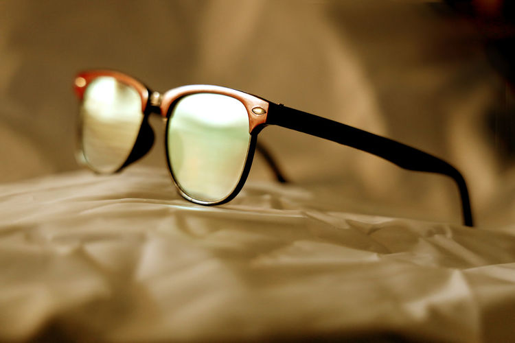 Close-up of eyeglasses on textile