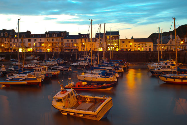 Ilfracombe Harbour Night #1 UK Architecture Building Exterior City Cloud - Sky Day Harbour Illuminated Mode Of Transport Moored Nautical Vessel Night Nightphotography No People Outdoors Pier Reflection Sea Sky Sunset Tranquility Transportation Travel Travel Destinations Water Yacht