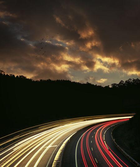 Light trails on road at dusk