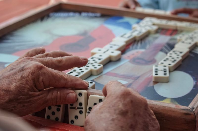 Senior Adult Tradition Culture Leisure Game Table Game Dominoes Domino Human Hand Hand Human Body Part Indoors  Body Part Real People One Person Lifestyles My Best Photo Streetwise Photography
