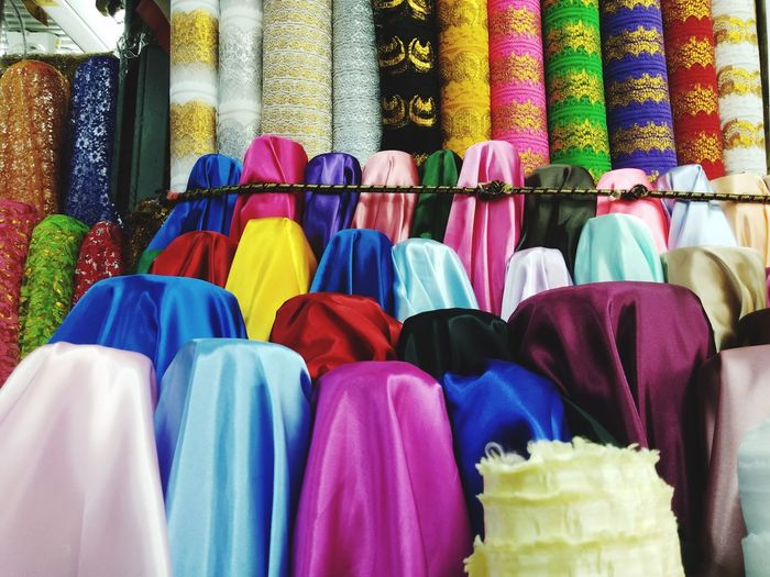 Close-up of multi colored textile for sale at store