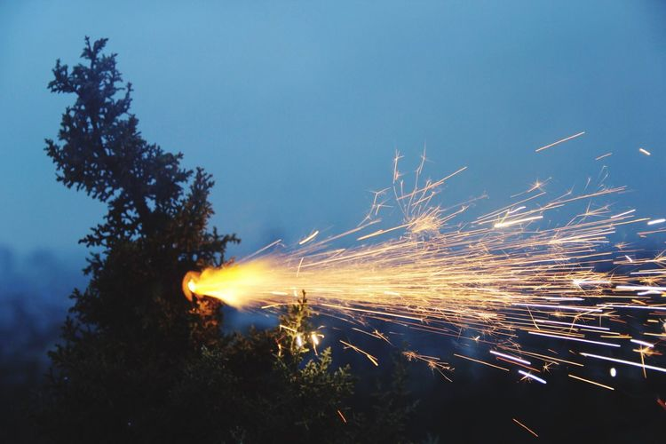 Sparks against sky at night