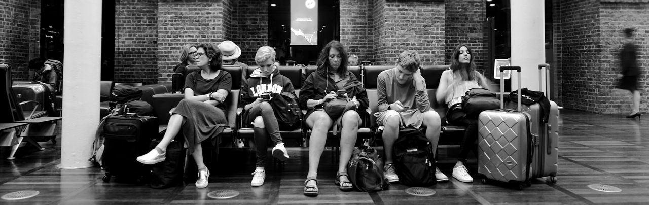 Black & White Black And White Blackandwhite Building Exterior Casual Clothing City City Life Group Of People In A Row Large Group Of People Men Outdoors People People Sitting Person Sitting St. Pancras Waiting Waiting Area
