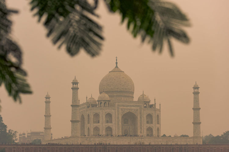 Low angle view of taj mahal against clear sky during sunset