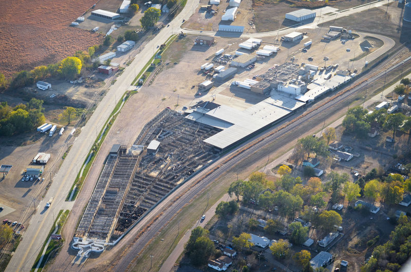 Stockyard Stock Livestock Cows Cattle Beef Agriculture Environment Operation Corral Street Road Highway High Angle View Aerial View Aerial Aerial Photography Animal Vegan Vegetarian Industry Trucking Transportation Built Structure Meat