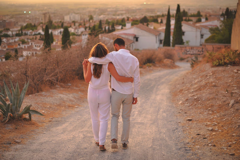 Casual Clothing Country Road Countryside Day Focus On Foreground Full Length Holding Outdoors Person Plantation Rear View Rural Scene Togetherness