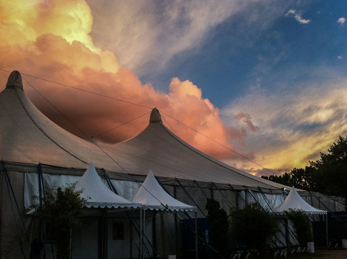 outside of the music pavilion at Tollwood Summer Festival, Munich Check This Out Cloud Cloud - Sky Color Palette Cumulus Cloud Dramatic Skies Dramatic Sky Eyeemphoto Eyeemphotography Festival Season Majestic Munich No People Outdoors Pavilion Tent Thunderstorm Tollwood Warm Colors Weather