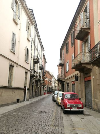 I am falling in love with beautiful Alessandria! No People Outside Wanderlust Wednesday Street Life Path Pathway Wanderlust Magical Italy Architecture Street Streetphotography Beautiful Beauty Narrow Narrow Street Wallpaper WallpaperForMobile Red Car Vehicle Vintage Vintage Cars Built Structure Sky Cityscape