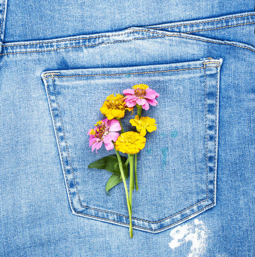Close-up of flowers on back pocket of jeans