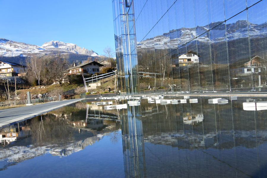 Architecture Beauty In Nature Building Exterior Built Structure Cable Cold Temperature Day Electricity Pylon Extreme Weather Mountain Mountain Range Nature No People Outdoors Reflection Sky Snow Water Winter