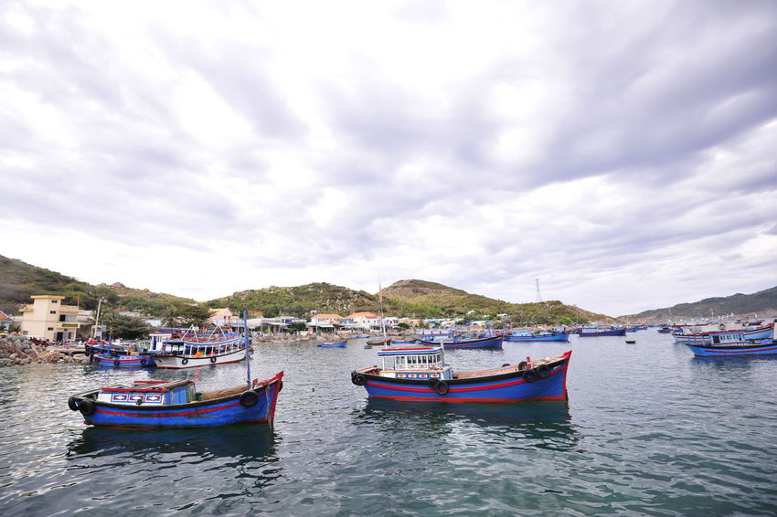 At Binh Hung island BinhHung Life Quiet Vietnam Anchored Beauty In Nature Cloud - Sky Fishing Boat Floating On Water Island Landscape Mode Of Transportation Nature No People Outdoors Quay Scenics - Nature Sea Sky Still Life Transportation Travel Destinations Vietnam Trip Water Waterfront