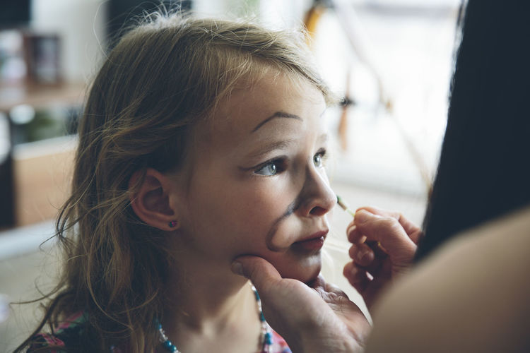 Little blond girl getting her face painted Art Artist Bonding Care Childhood Close-up Cute Day Drawing Face Paint Face Painting Façade Girls Headshot Indoors  Innocence Love Make-up Makeup Painting Party People Real People Togetherness The Portraitist - 2018 EyeEm Awards