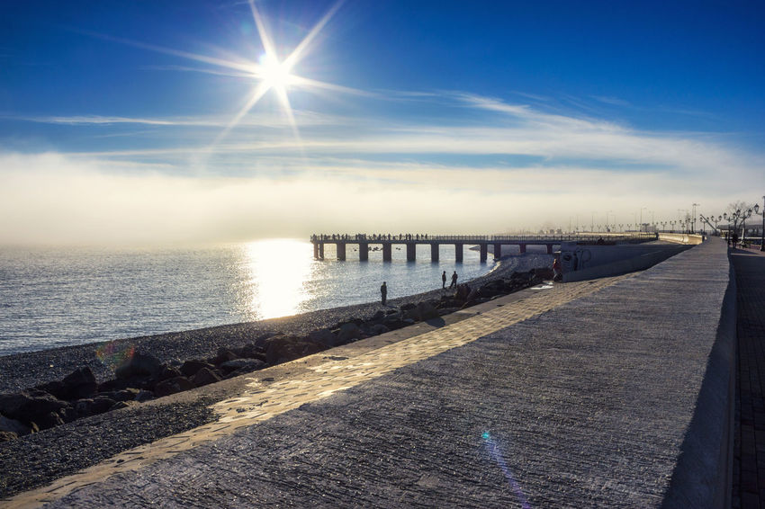 Beauty In Nature Blue Bright Cloud Cloud - Sky Day Horizon Over Water Idyllic Lens Flare Nature No People Outdoors Pier Rippled Scenics Sea Sky Sun Sunbeam Sunlight Sunny The Way Forward Tranquil Scene Tranquility Water