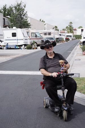 Old But Awesome Campground Cowboy Portrait of a Man with a Dog Taking Photos Eye4photography  Losangeles California