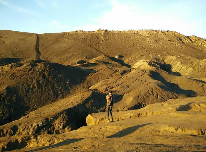 Rear View Of Man Standing Against Mt Bromo