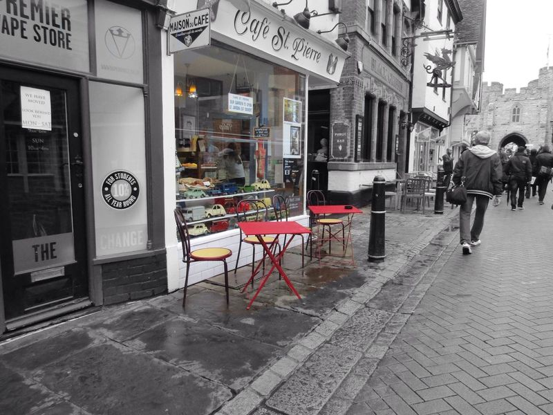 Cafe Architecture Built Structure Building Exterior Street Road City Life City Sidewalk Cafe Person Paving Stone Day Outdoors Commercial Sign