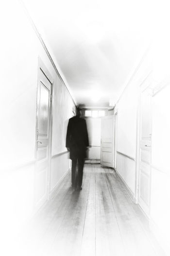 Architecture Blackandwhite Corridor Day Doors Full Length Ghost Halloween Hotel Indoors  Lifestyles Men Monochrome Photography Motion Blur One Person People Real People Rear View The Way Forward Walking