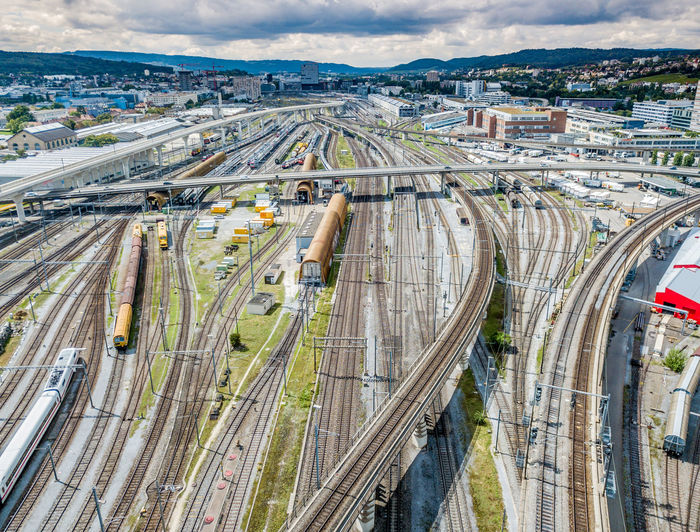 High Angle View Of Trains On Railroad Tracks In City