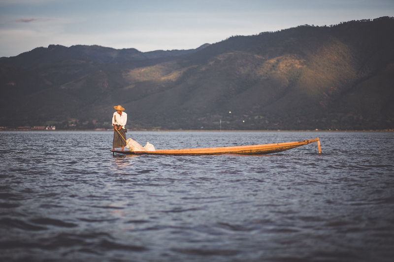 Life Beauty In Nature Fisherman Inle Lake Mountain Myanmar One Person Sea Sky Transportation Water