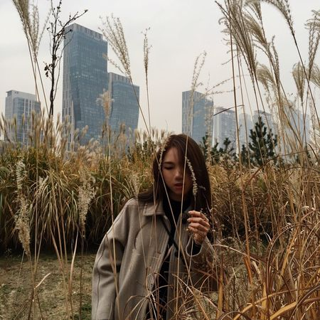 Enjoy The New Normal One Person Leisure Activity City Young Adult Built Structure Lifestyles Sky Outdoors Young Women Architecture Holding Real People Building Exterior Day Portrait One Woman Only Only Women People Adults Only Adult Fall