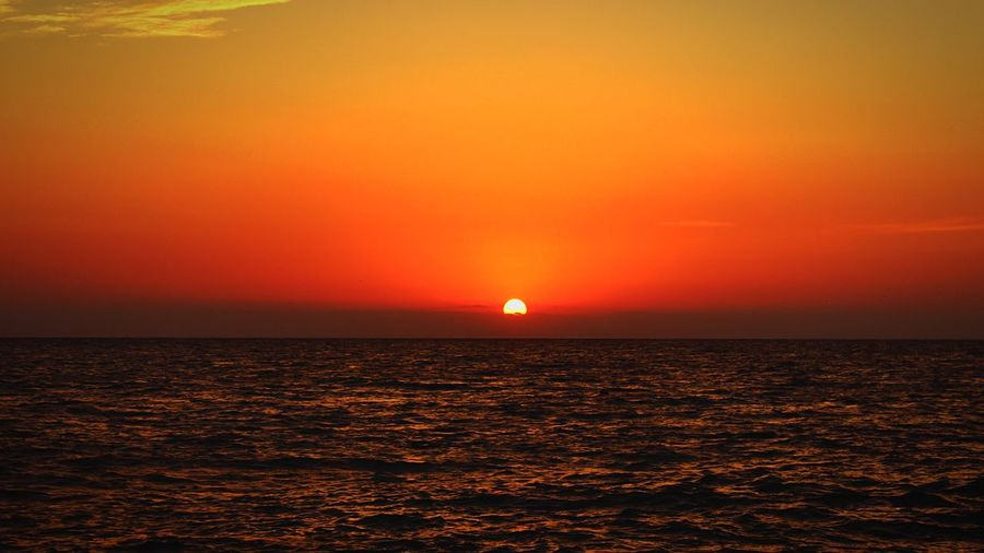 Sea Horizon Over Water Scenics Sunset Beauty In Nature Nature Tranquil Scene Water Idyllic Sky Outdoors No People Horizon Day Orange Color Sun