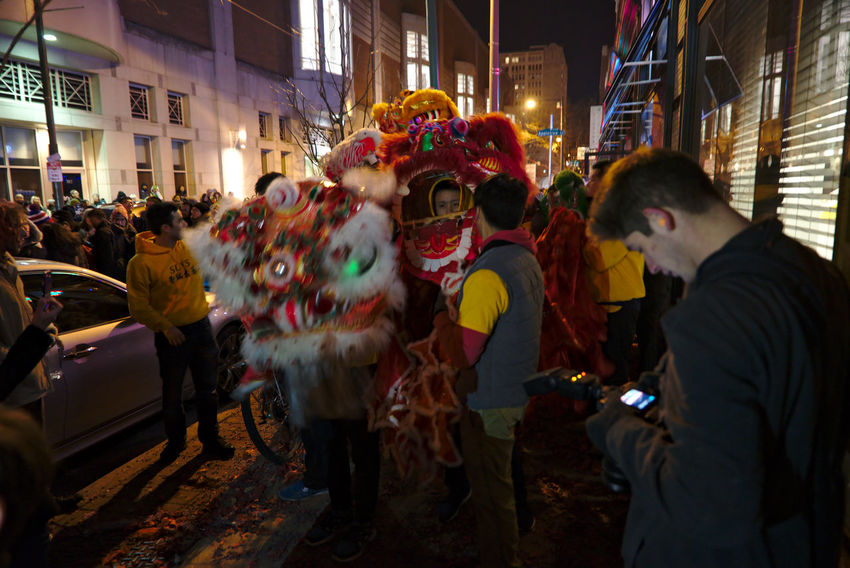 Philadelphians celebrate the Year of the Rooster with Chinese lion dances, fire crackers and more. Adult China Town Phil Chinatown Chinese New Year Chinese New Year 2016 Chinese New Year 2017 Color Colorful Crowd Light Night Photography Outdoors Parade Participant People People Watching Philadelphia Real People