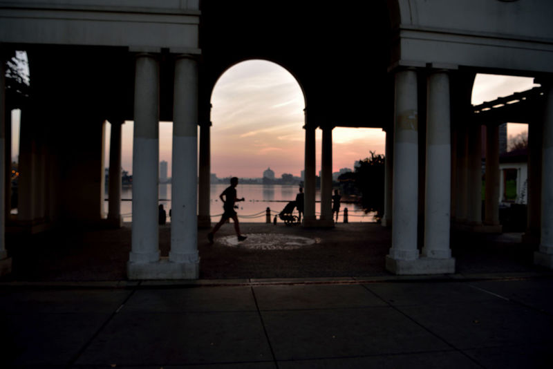 Sunset At Lake Merritt 7 Oakland, Ca. Sunset Sundown Sunset_collection Sunset Silhouettes Reflections Reflected Glory Reflections In The Water Sun's Glow Pergola Colonnade Urban Skyline Urban Photography People Watching Man Jogging City Emblem Cityscape Superior Court House Skyscrapers Shadows Landscape Landscape_photography Landscape_photography Architecture Architectural Column