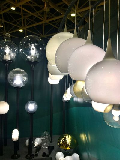 Low angle view of illuminated light bulbs hanging from ceiling
