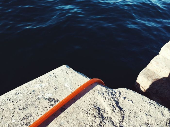Water High Angle View Day Nature No People Sunlight Outdoors Tranquility Beauty In Nature Lake Close-up Hosepipe Orange Color Orange Blue Harbour Alicante, Spain Abstract Stone Wall