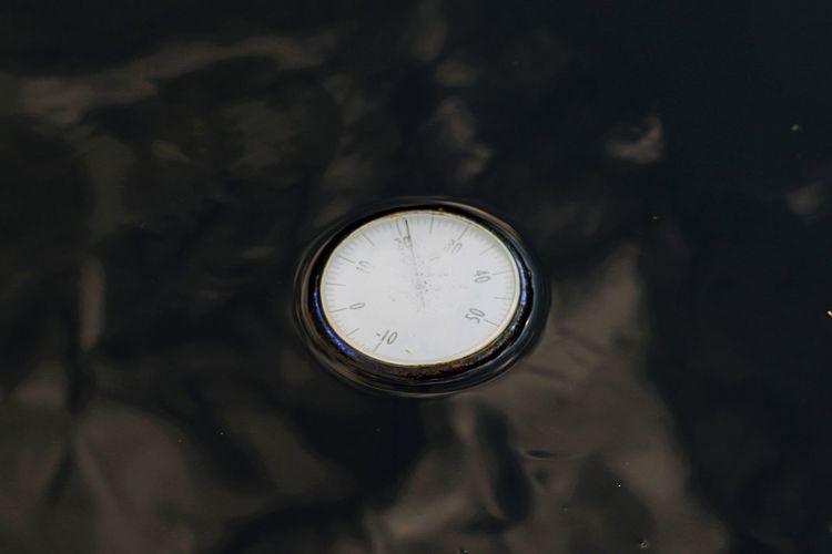 High Angle View Of Pressure Gauge Floating On Water