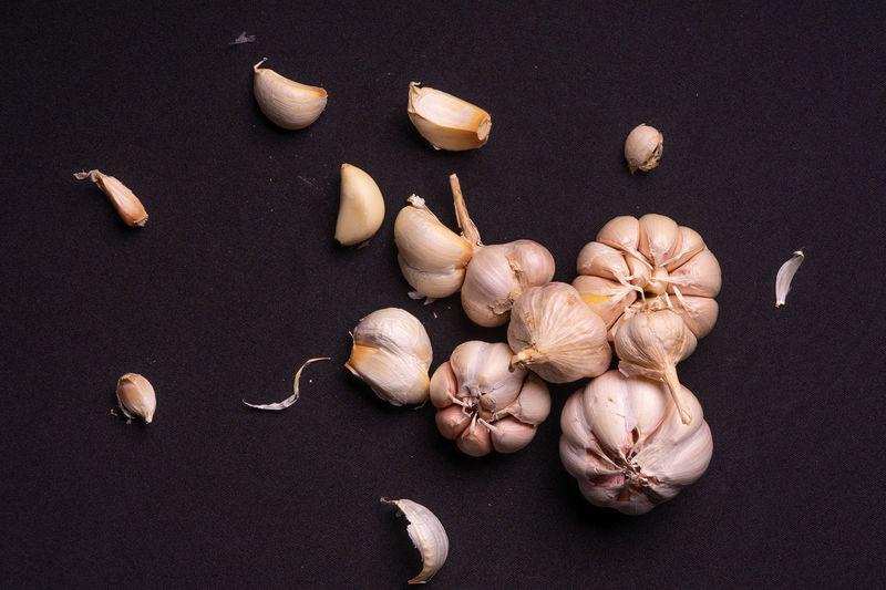 High angle view of garlic on table