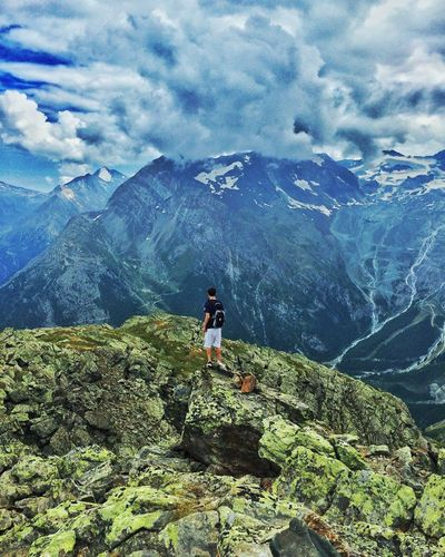 Mountain Adventure Nature Hiking Mountain Range Scenics Cloud - Sky Landscape One Person Outdoors Switzerland Alps Lichen Sky Beauty In Nature Elevated View Vast Natural WOW