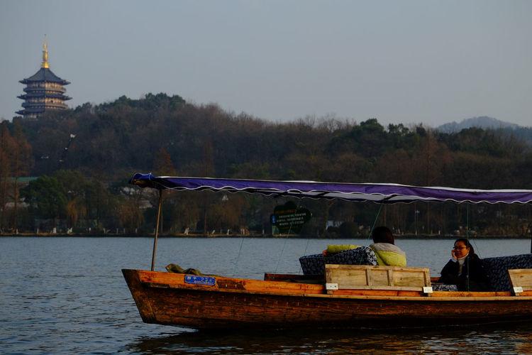Xihu Lake, Hangzhou, China. Adult Beauty In Nature Boat China Day Fujifilm Fujifilm_xseries Hangzhou Lake Nature Nautical Vessel Outdoors People River Ship Sky Travel Destinations Tree Vessel Water XiHu