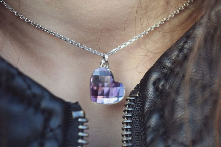 Close-up of woman diamond necklace