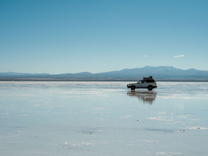 Driving through the salt flats Beauty In Nature Clear Sky Copy Space Day Idyllic Mode Of Transportation Mountain Nature Nautical Vessel No People Outdoors Scenics - Nature Sea Sky Tranquil Scene Tranquility Transportation Travel Water Waterfront