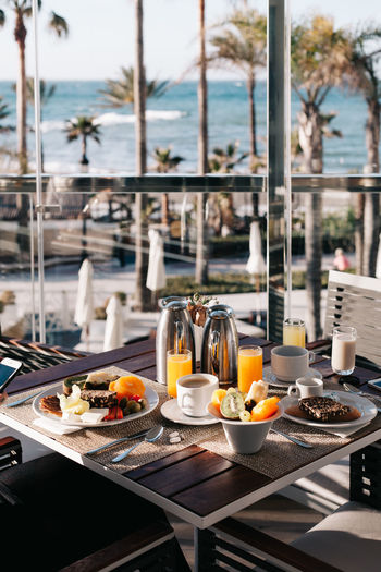 Breakfast Container Crockery Day Drink Focus On Foreground Food Food And Drink Freshness Fruit Glass Healthy Eating Hotel Hotel Breakfast Household Equipment Meal No People Plate Refreshment Restaurant Sea View Table Tray Tropical Breakfast Wellbeing