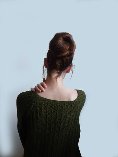 Joung Lady Offshoulder Backpain Finger Woman Girl NeckPain Neck Shoulders Sweather Sad Studio Shot Girls Back Studio Shot Rear View Long Hair Hair Bun Society Beauty Back Hairstyle
