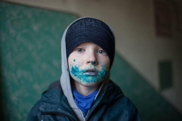 Portrait of boy with paint on face