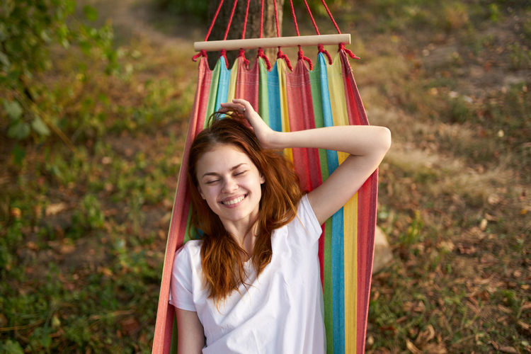 Smiling woman sitting in hammock