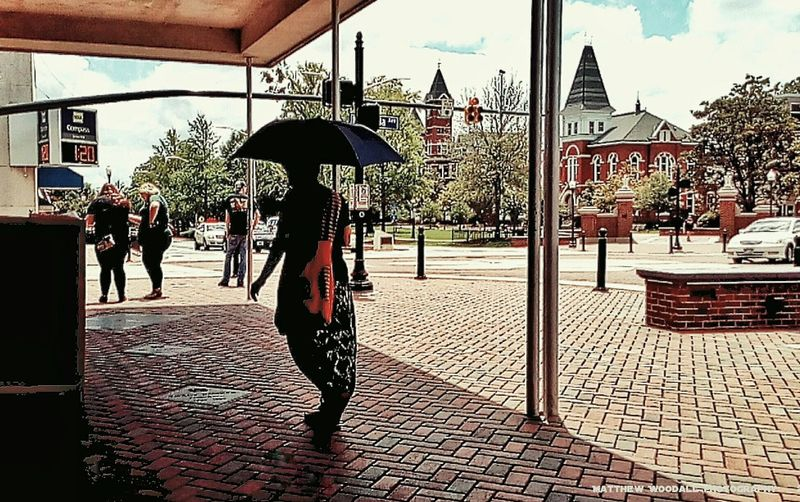 'Sunshine in the shade' ..last one for now. Everyone was looking at this lady, with an umbrella out on a sunny hot day. Anyways, may you all have a happy and peaceful week ahead. :-) ✌ Sidewalk Photograhy Street Photography Auburn, Alabama Sunshine ☀ College Life College Town Auburn University Colour Of Life Android Photography Snapseed