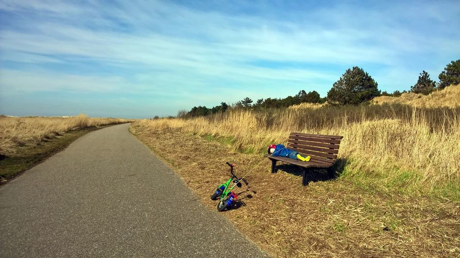 Bench Kids Bike Petulant Beauty In Nature Boy Break Bycicle Bycicle Tour Cloud - Sky Day Family Time Grass Landscape Men Nature One Person Outdoors People Real People Rest Scenics Sky Tired Legs Tourism